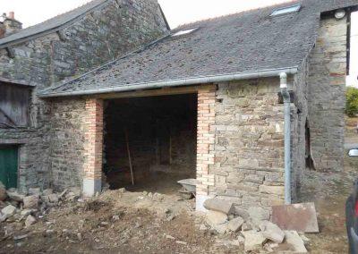 Création d'ouverture et maçonnerie de briques de terre cuite sur façade en pierre